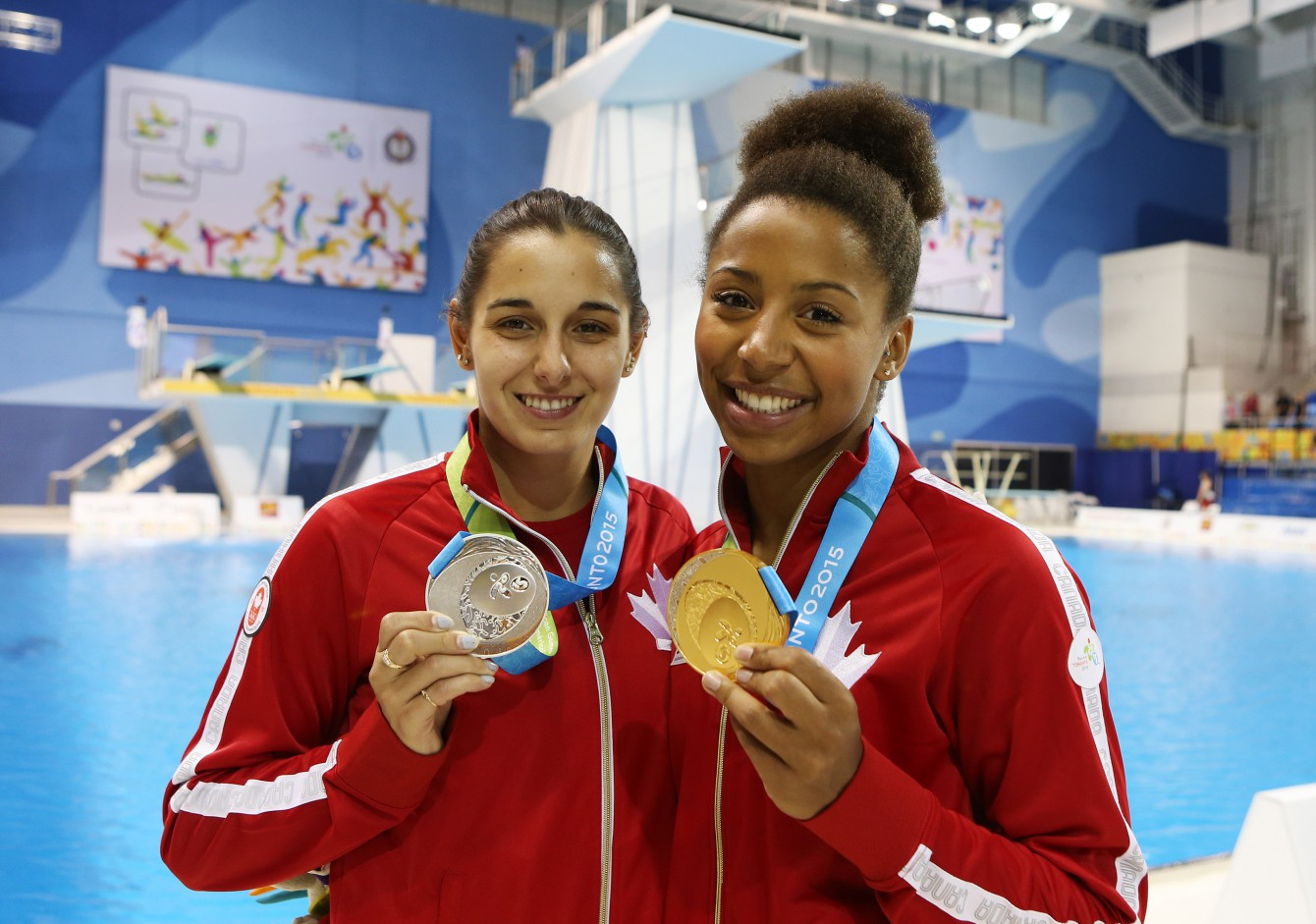 TORONTO, ON - JULY 12:  Pamela Ware of Canada wins Silver and Jennifer Abel of Canada wins Gold in the Women's 3m Springboard Final during the Toronto 2015 Pan Am Games at the CIBC Aquatic Centre on July 12, 2015 in Toronto, Ontario, Canada.  (Photo by Vaughn Ridley/Canada Diving)