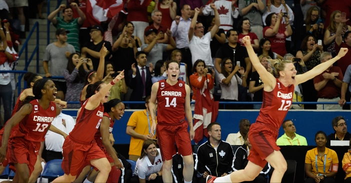 Canadian players run to the middle of the court at the buzzer after beating USA in Pan Am Games basketball for gold on July 20, 2015.