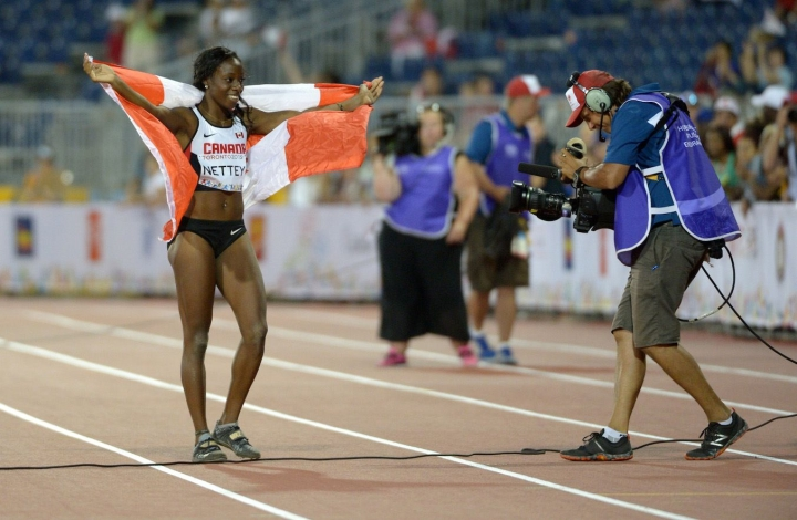 Christabel Nettey celebrating with the Canadian flag