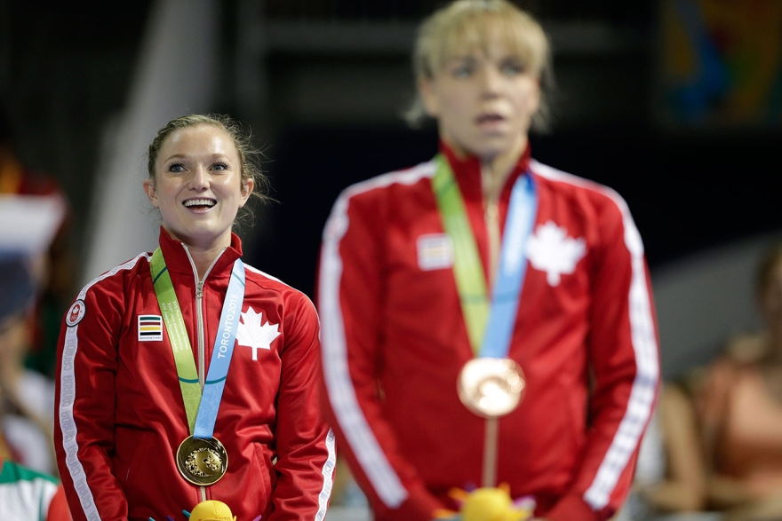Canada's Rosie MacLennan listens to 'O Canada' after receiving her gold medal at TO2015. Her teammate Karen Cockburn took the bronze.