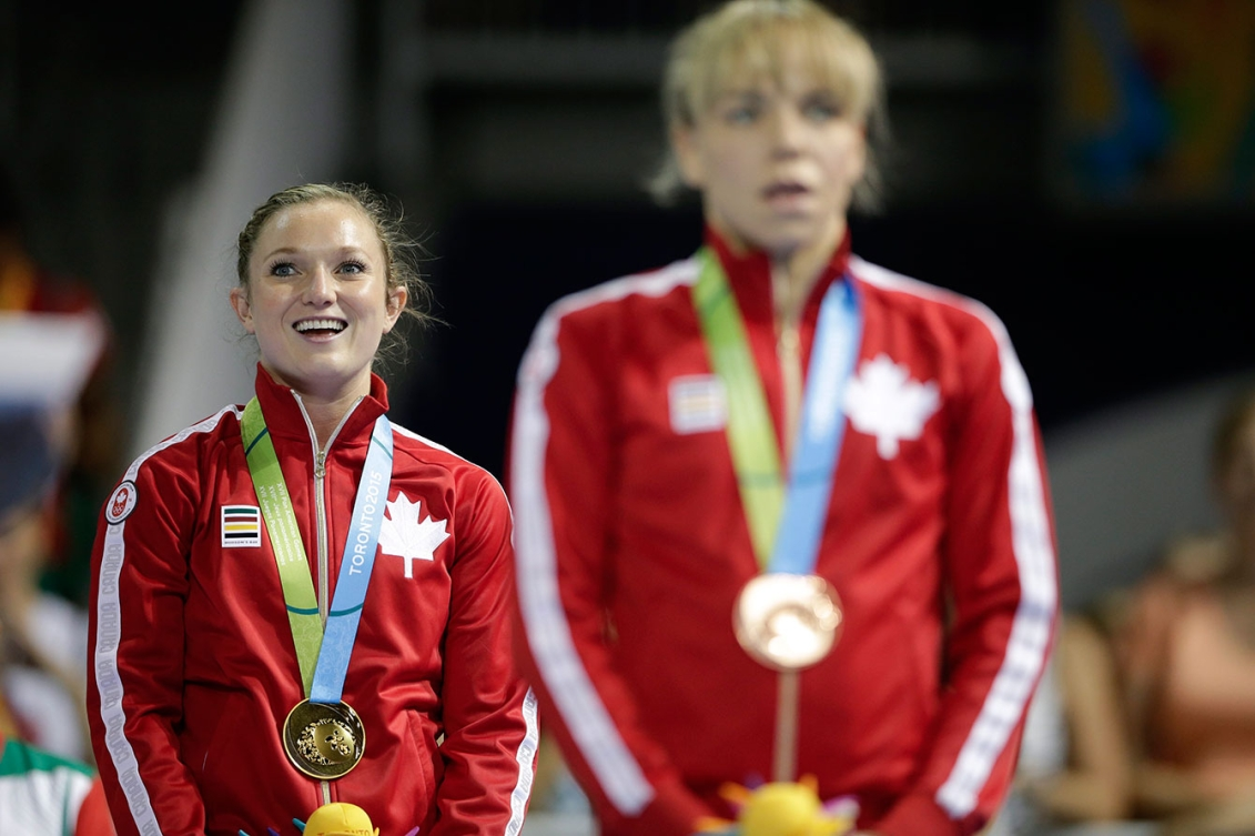 Canada's Rosie MacLennan listens to 'O Canada' after receiving her gold medal. Her teammate Karen Cockburn took the bronze.