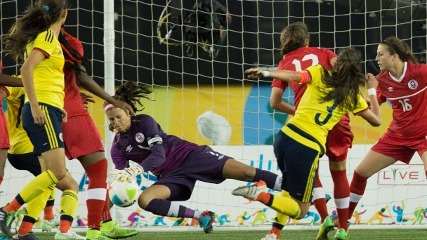 Canadian goalkeeper Stephanie Labbe stops a shot during Pan Am Games football semifinal against Colombia on July 22, 2015.