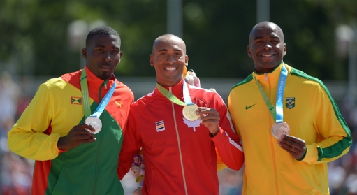 Damian Warner poses with his medal