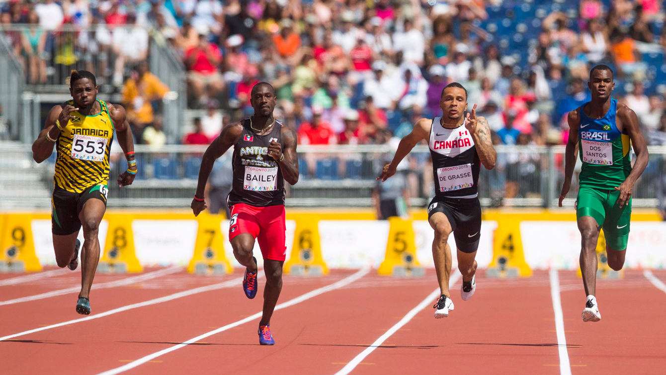 Andre De Grasse (second from right) competes in the 100m quarterfinals at Pan Am Games on July 21, 2015.
