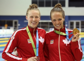Hilary Caldwell (right) and Dominique Bouchard (left) take gold and silver in the 200m Backstroke at TO2015.