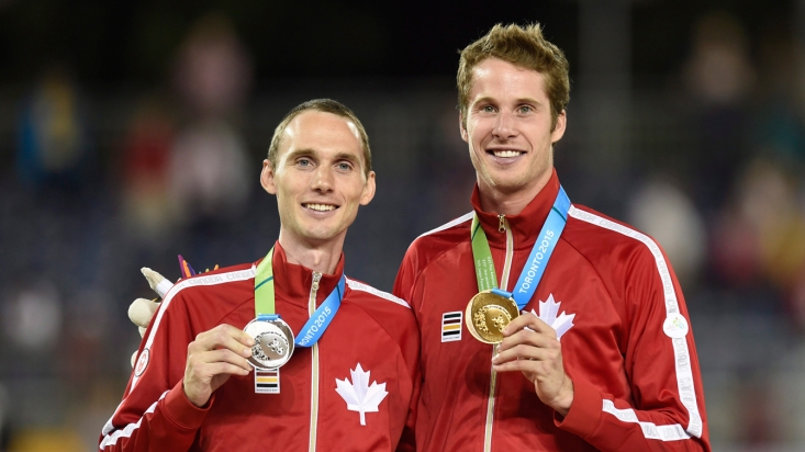 Derek Drouin (right) and Mike Mason (left) celebrate gold and silver after the men's high jump final at the 2015 Pan Am Games on July 25, 2015. (THE CANADIAN PRESS/Frank Gunn)