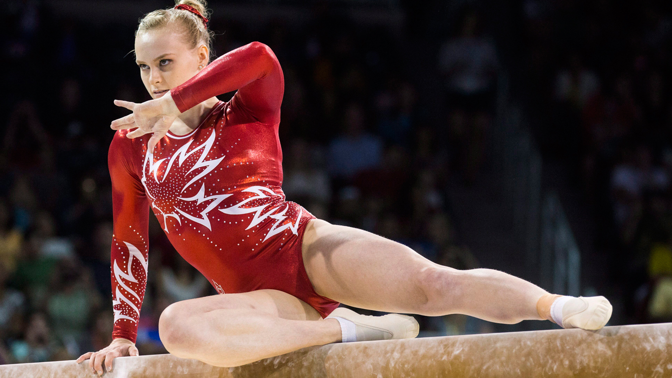 Ellie Black on her way to winning a gold medal in the artistic gymnastics balance beam at the Pan Am Games on July 15, 2015. (THE CANADIAN PRESS/Mark Blinch)