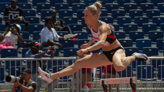 Sarah Wells competes in the women's 400m hurdles