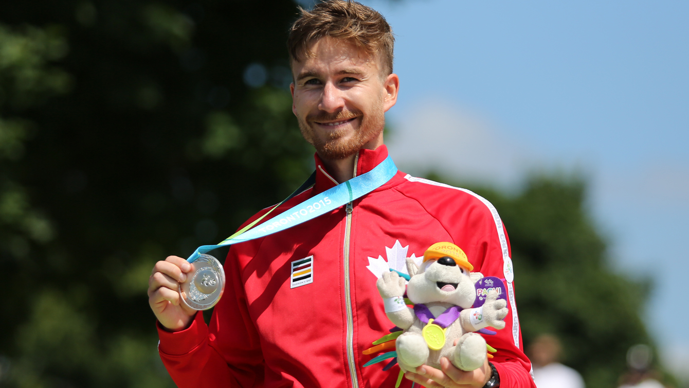 Inaki Gomez holds up his Pan Am Games race walk silver medal on July 19, 2015.