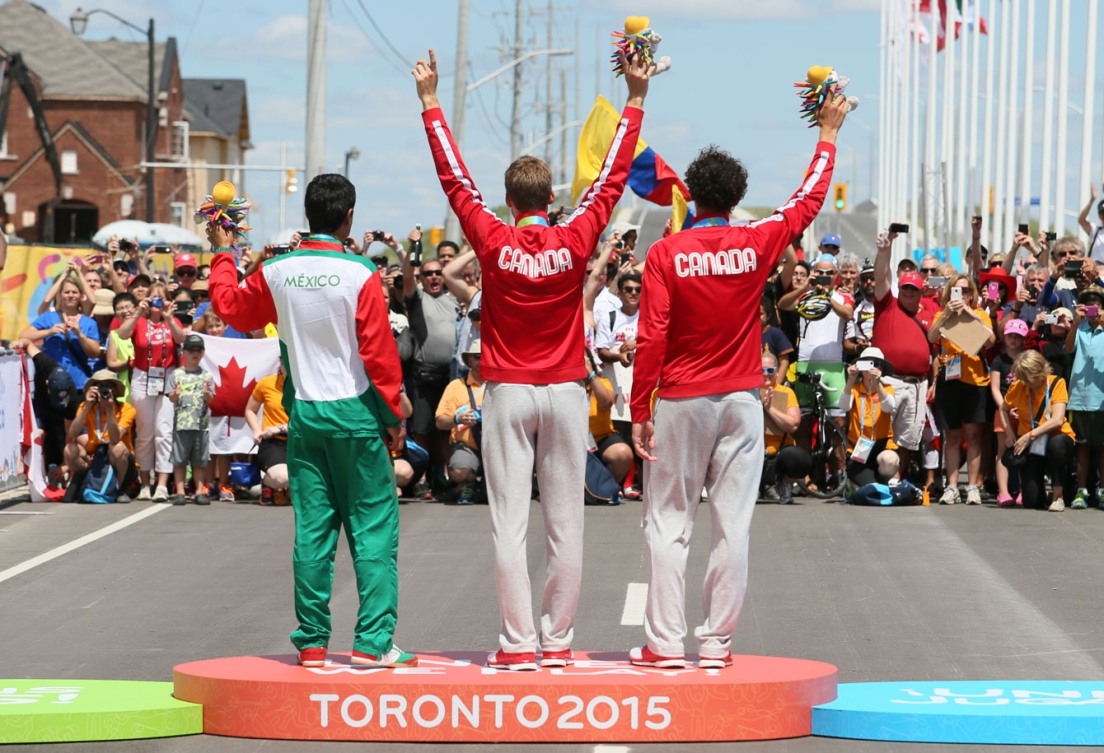 Hugo Houle won gold and teammate Sean MacKinnon took bronze in the men's road race at Toronto 2015 on July 22nd.