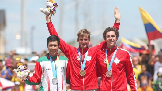 Medalists, from left Ignacio Prado of Mexico, silver, Hugo Houle of Ste-Perpetue, Que, gold and Sean MacKinnon of Hamilton, Ont.. bronze, in the cycling time trial at the Pan American Games