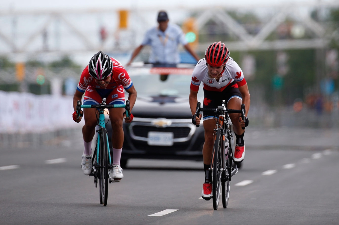 Jasmin Glaesser (right) and Cuba's Marlies Majias sprint to the finish of the women's road race. Glaesser won.