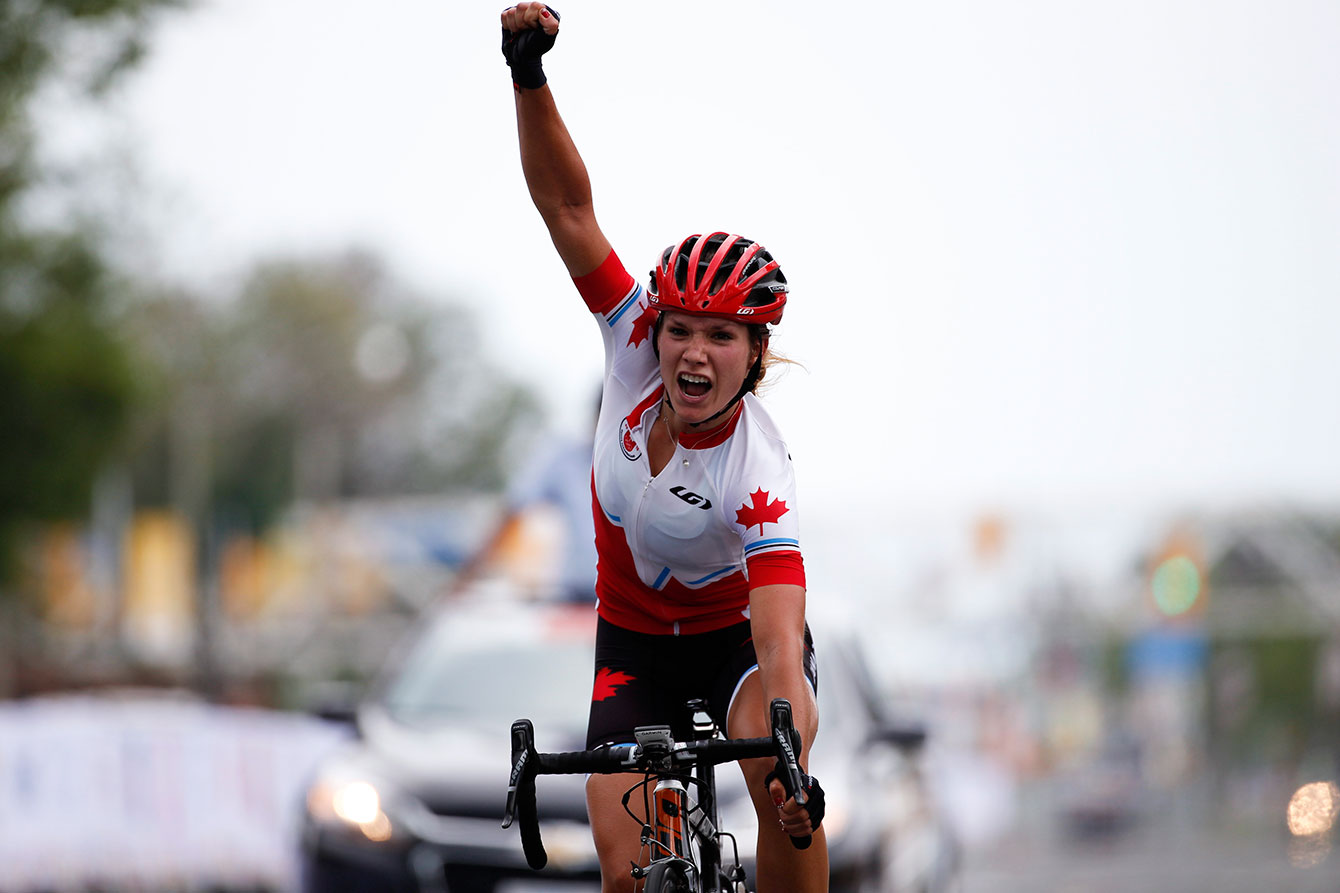 Jasmin Glaesser celebrates after winning the TO2015 cycling road race.