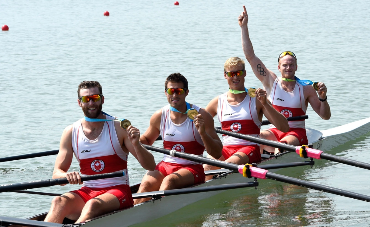 The men's coxless four crew celebrate their gold medal. From left to right: Conlin McCabe, Kai Langerfeld, Tim Schrijver and Will Crothers. (Photo: Jason Ransom)