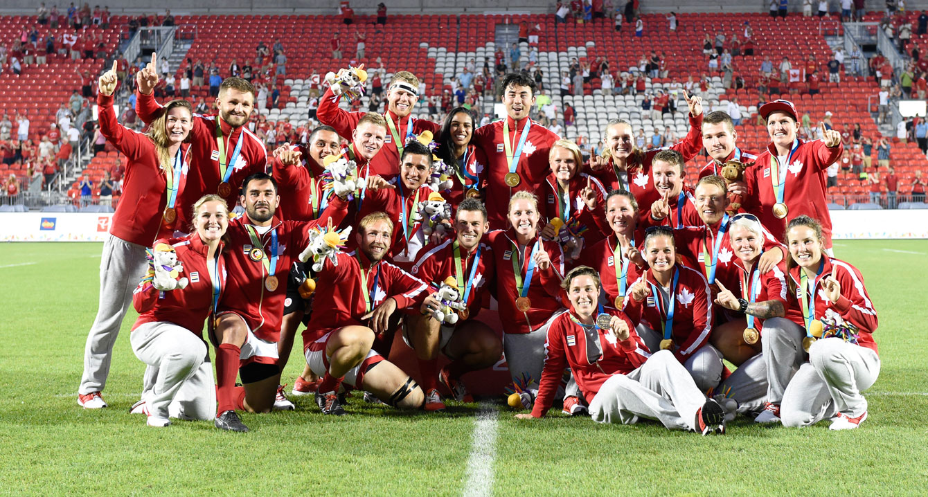 The men's and women's team gather with their gold medals to celebrate what was a special day in the history of Rugby in Canada. (Photo: Jason Ransom)