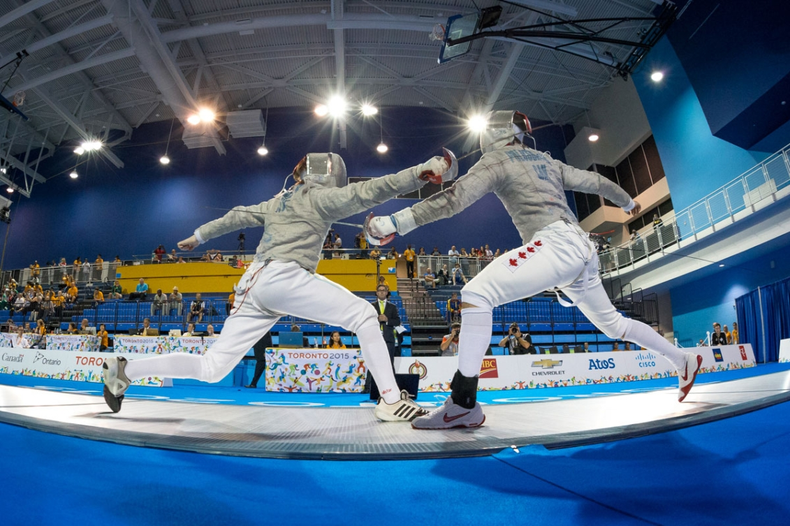 Joseph Polossifakis (right) helped the men's sabre team win TO2015 gold.