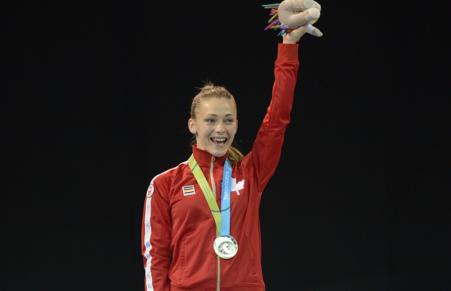 Kate Campbell smiling with her medal
