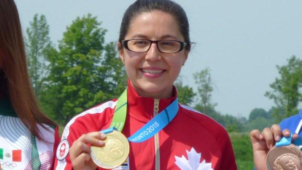 Lynda Kiejko with her 10m air pistol shooting gold medal at the Pan American Games on July 12, 2015.