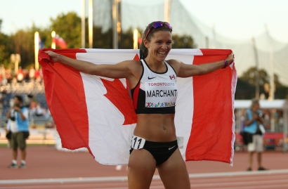 Lanni Marchant with the Canadian flag