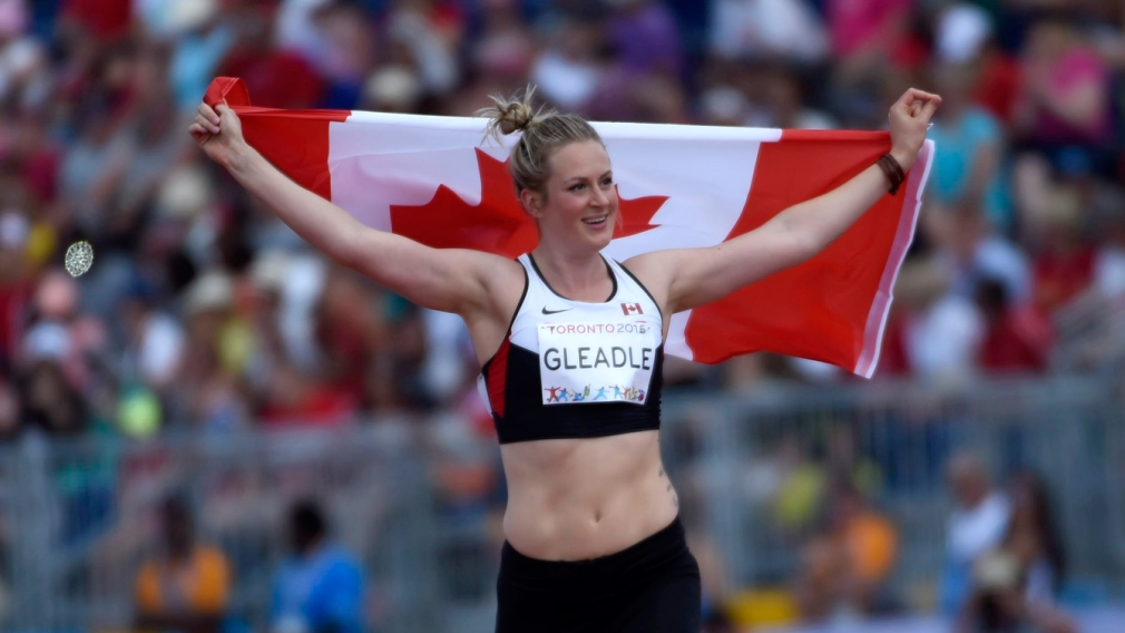 Liz Gleadle Holding Canadian Flag during her victory lap