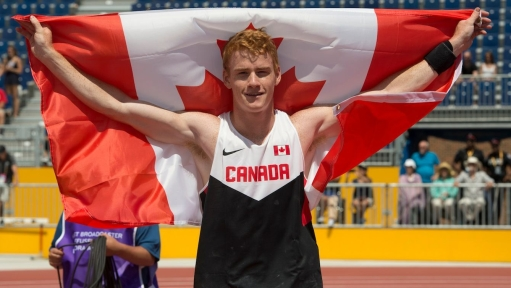 Shawnacy Barber celebrates gold in the men's pole vault