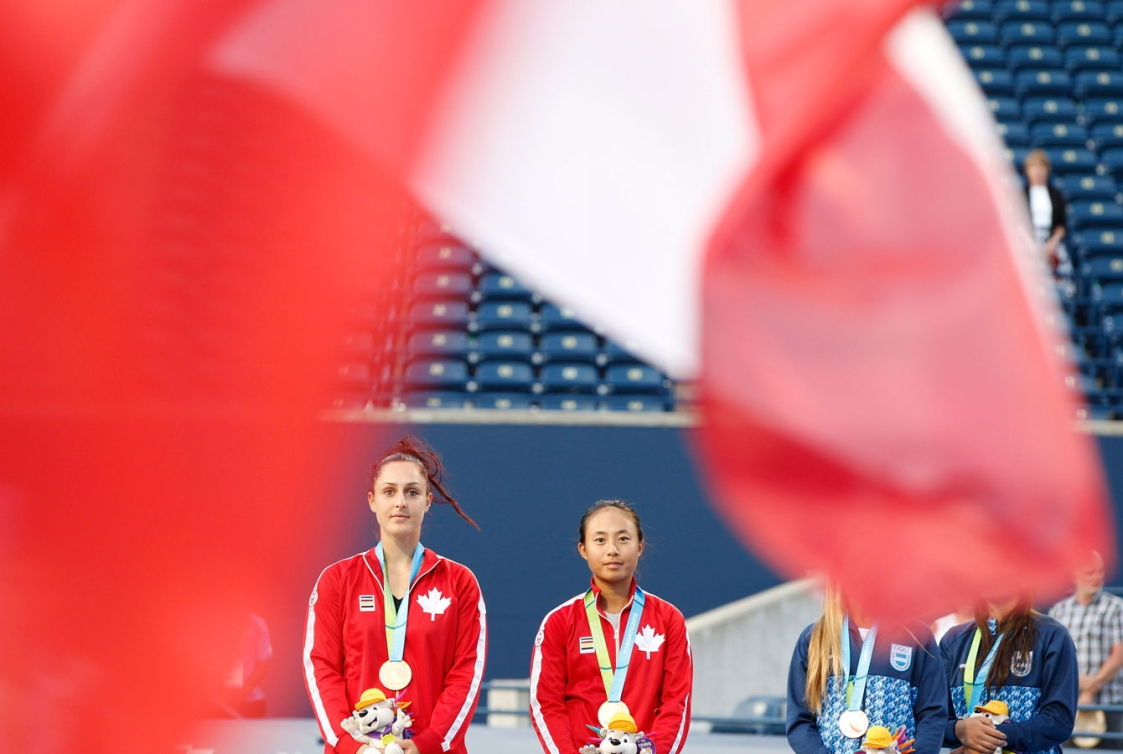 Gabriela Dabrowski (left) and Carol Zhao listen to O'Canada after winning women's doubles gold. (Photo: David Jackson)