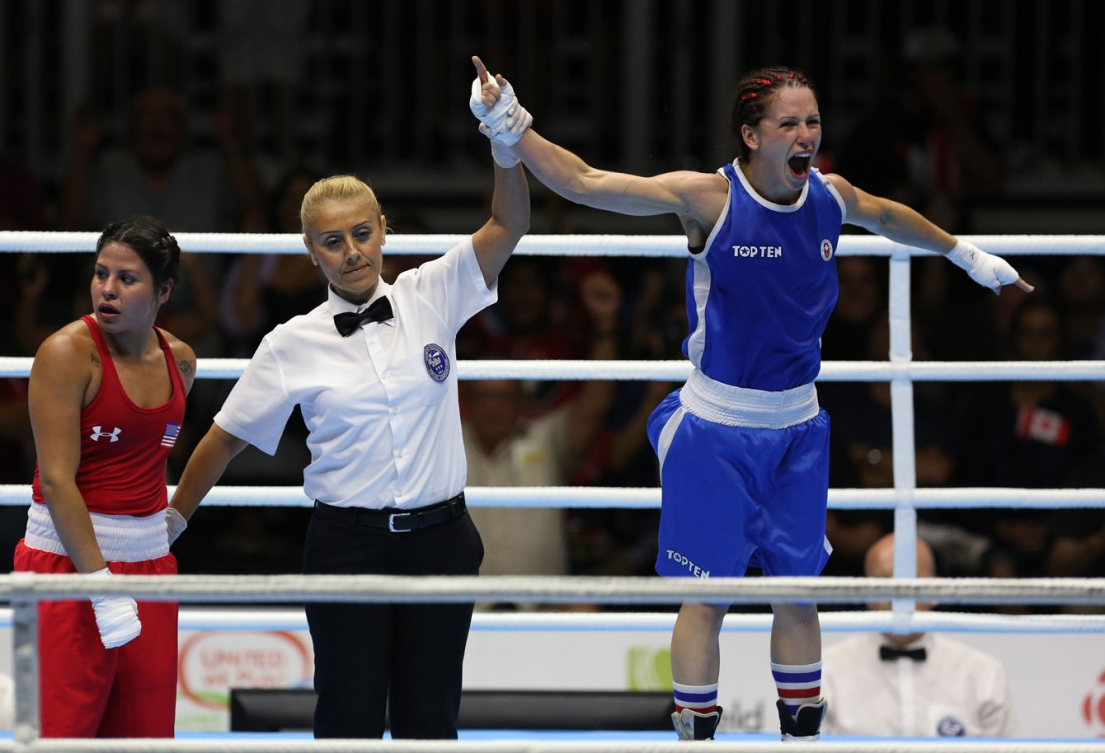 Mandy Bujold celebrates her TO2015 gold in the women's fly (48-51kg) division on Day 15.