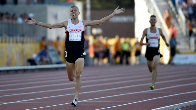 Matt Hughes celebrates gold in the men's 3000m steeplechase