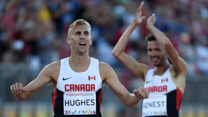 Matt Hughes and Alex Genest celebrate gold and silver, respectively, in the men's 3000m steeplechase