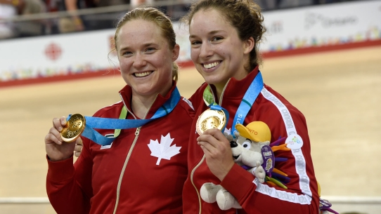 Kate O'Brien (left) and Monique Sullivan after winning gold in the women's team sprint at Pan Am Games track cycling event on July 16, 2015.