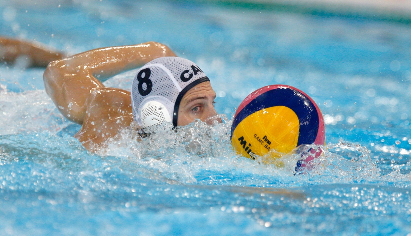 Kevin Graham moves the ball during the men's water polo bronze medal match. (Photo: Michael Hall)