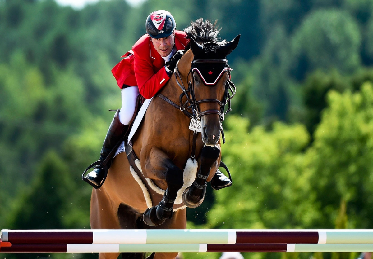 Ian Millar jumping in equestrian at Olympic Games