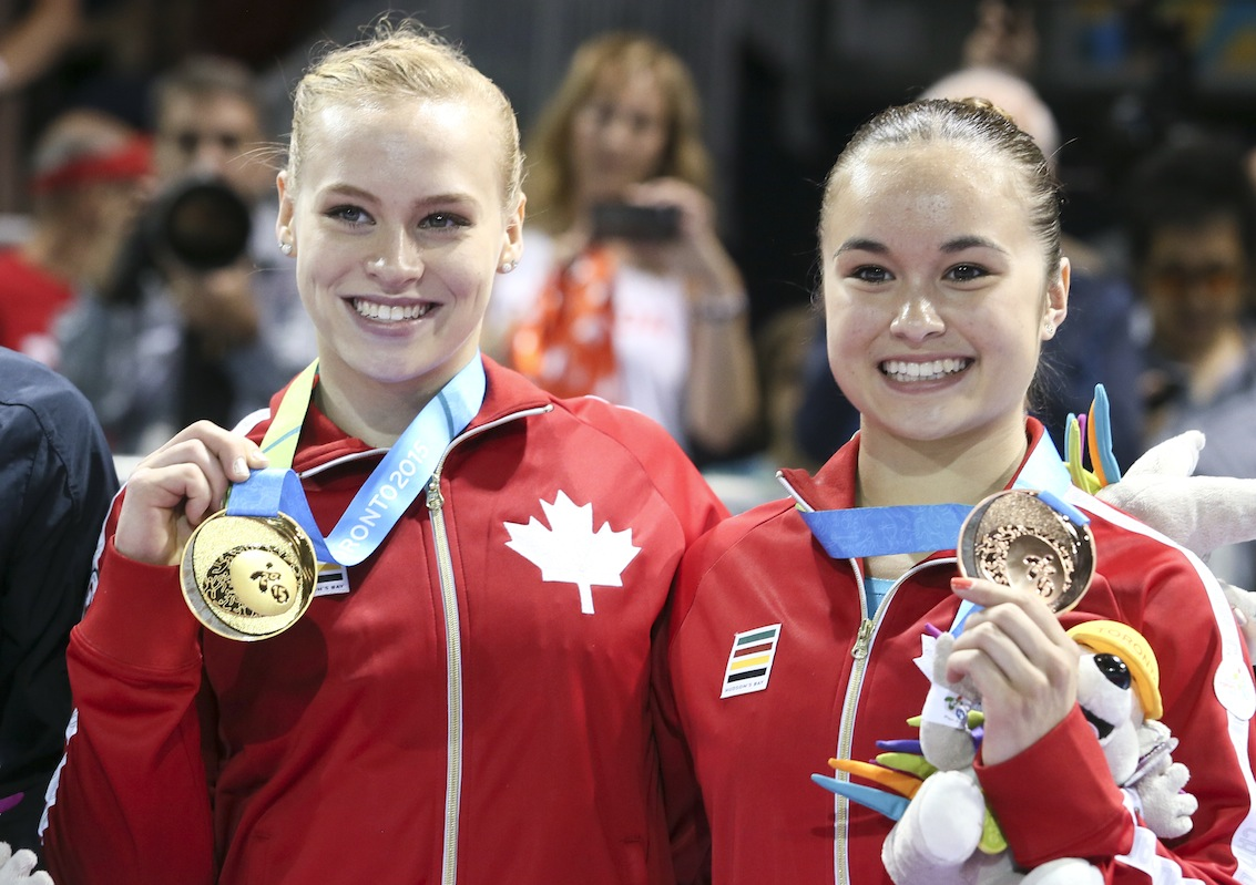 Ellie Black (left) of Halifax takes gold and Victoria Woo (right) of Brossard, Que. takes bronze in artistic gymnastics (beam) at the PanAmerican Games on July 15, 2015.