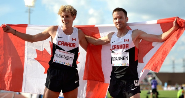 Nate Brannen and Charles Philibert-Thieboutot celebrating with Canadian flags