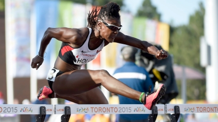 Nikkita Holder competes in the women's 100m hurdles event