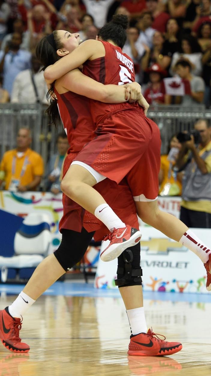 Kia Nurse jumps into the arms of a teammate as Canada beats USA 81-73 for Pan Am Games basketball gold on July 20, 2015.