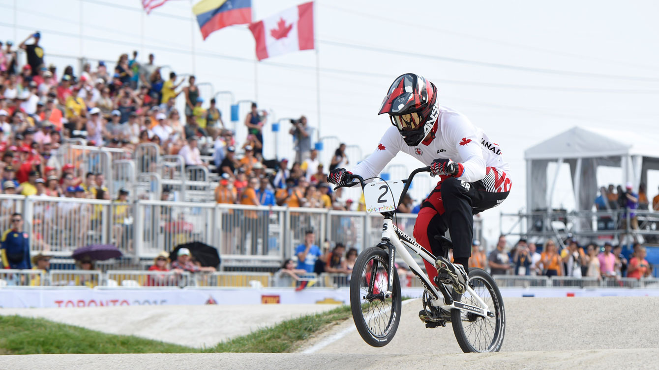 Tory Nyhaug races from the front at men's BMX Pan Am Games competition on July 11, 2015.