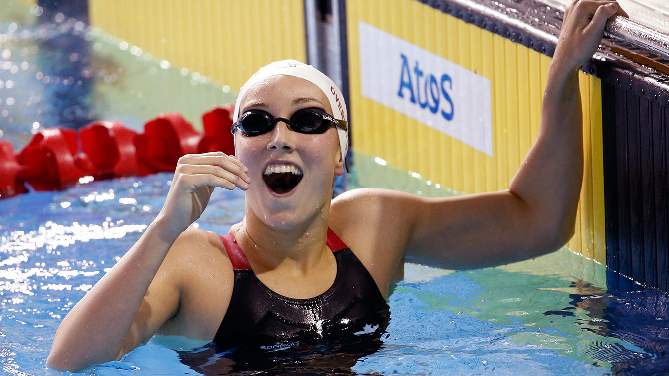 Canada's Emily Overholt is overjoyed after swimming to gold in the women's 400m freestyle.