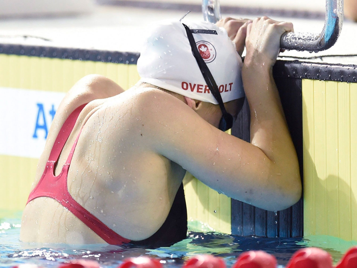 Emily Overholt holds on to the side of the pool after a race