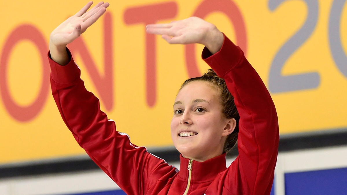 Emily Overholt waving to the crowd