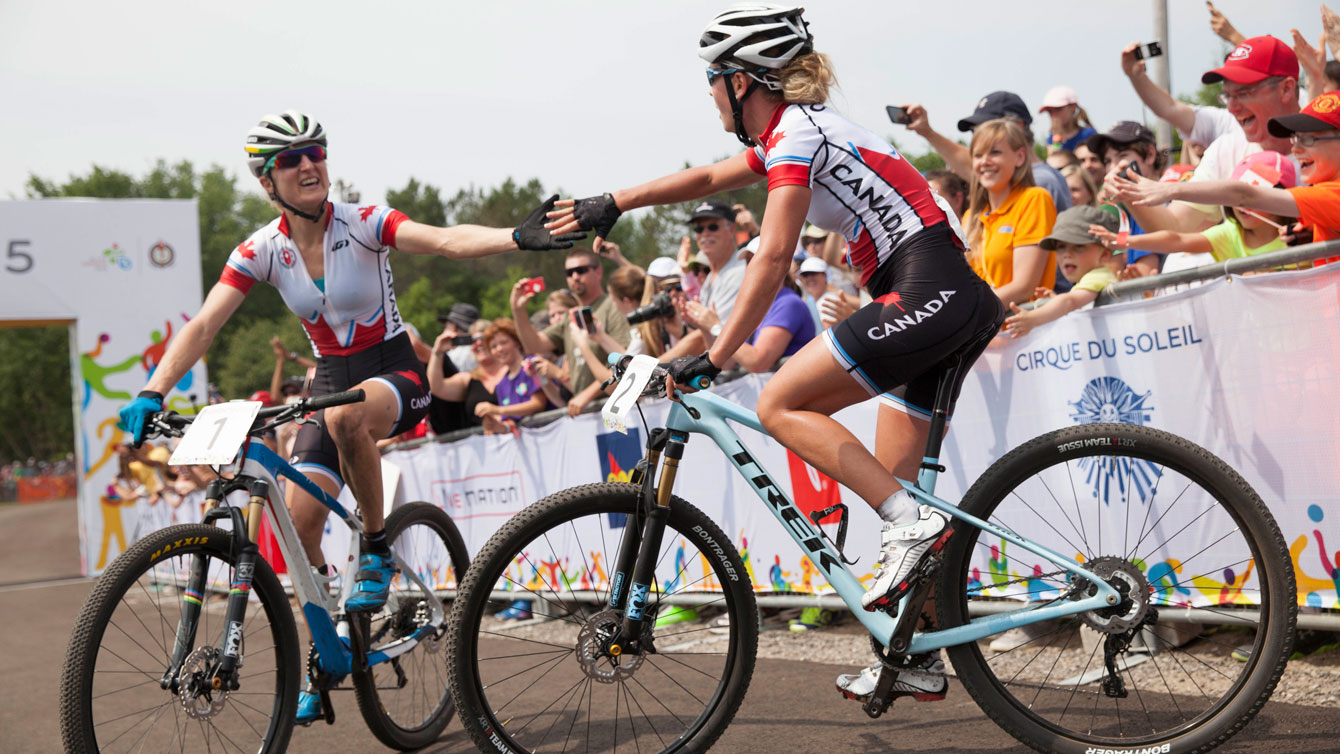 Catharine Pendrel (left) and Emily Batty congratulate each other following Pan Am Games mountain bike race. Batty was first, Pendrel second on July 12, 2015.