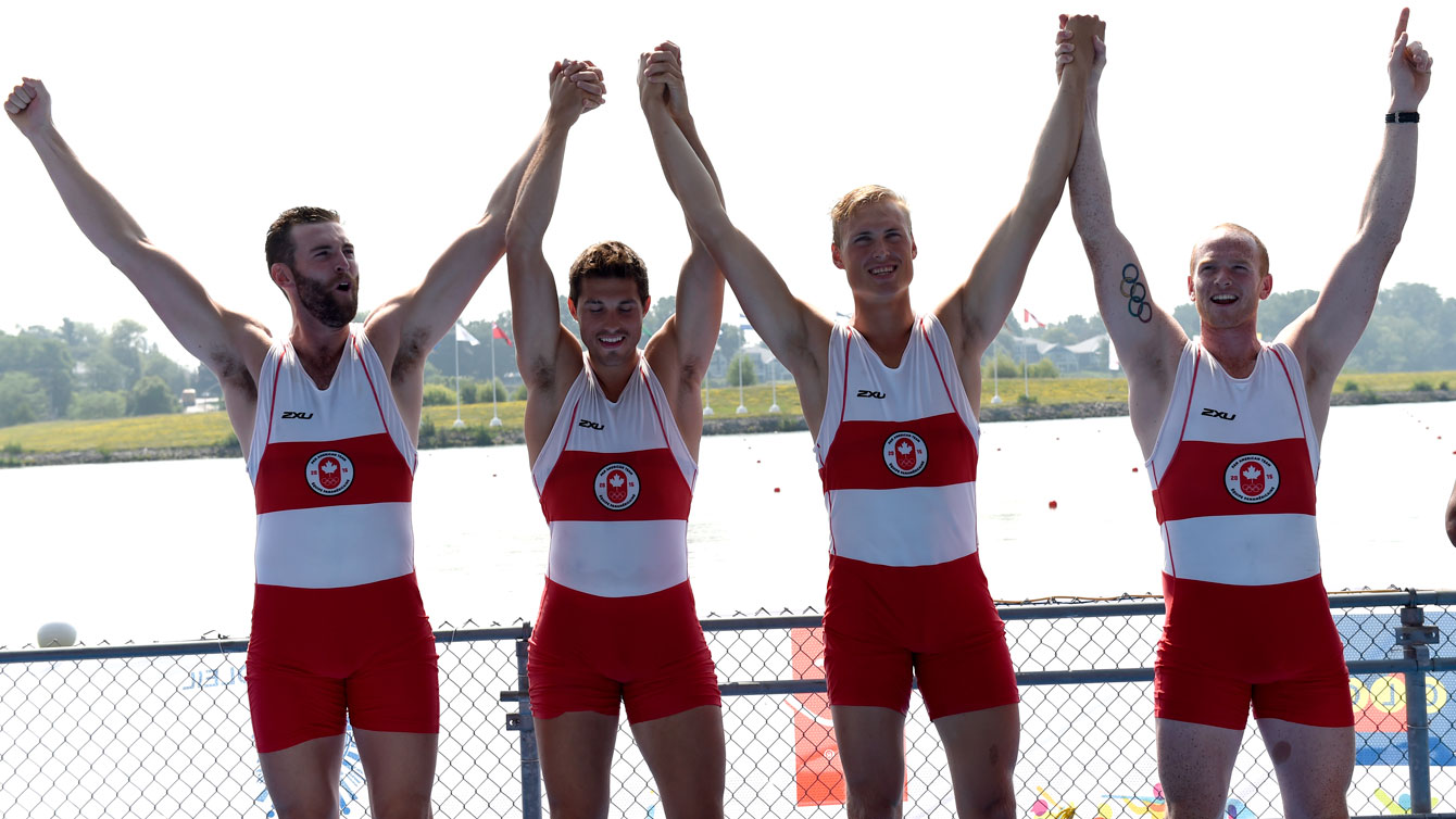 Conlin McCabe, Kai Langerfeld, Tim Schrijver and Will Crothers celebrate their Pan Am Games coxless four win on July 13, 2015