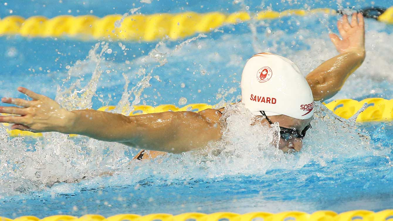 Katerine Savard swims the 100m butterfly at the Toronto 2015 Pan Am Games. .