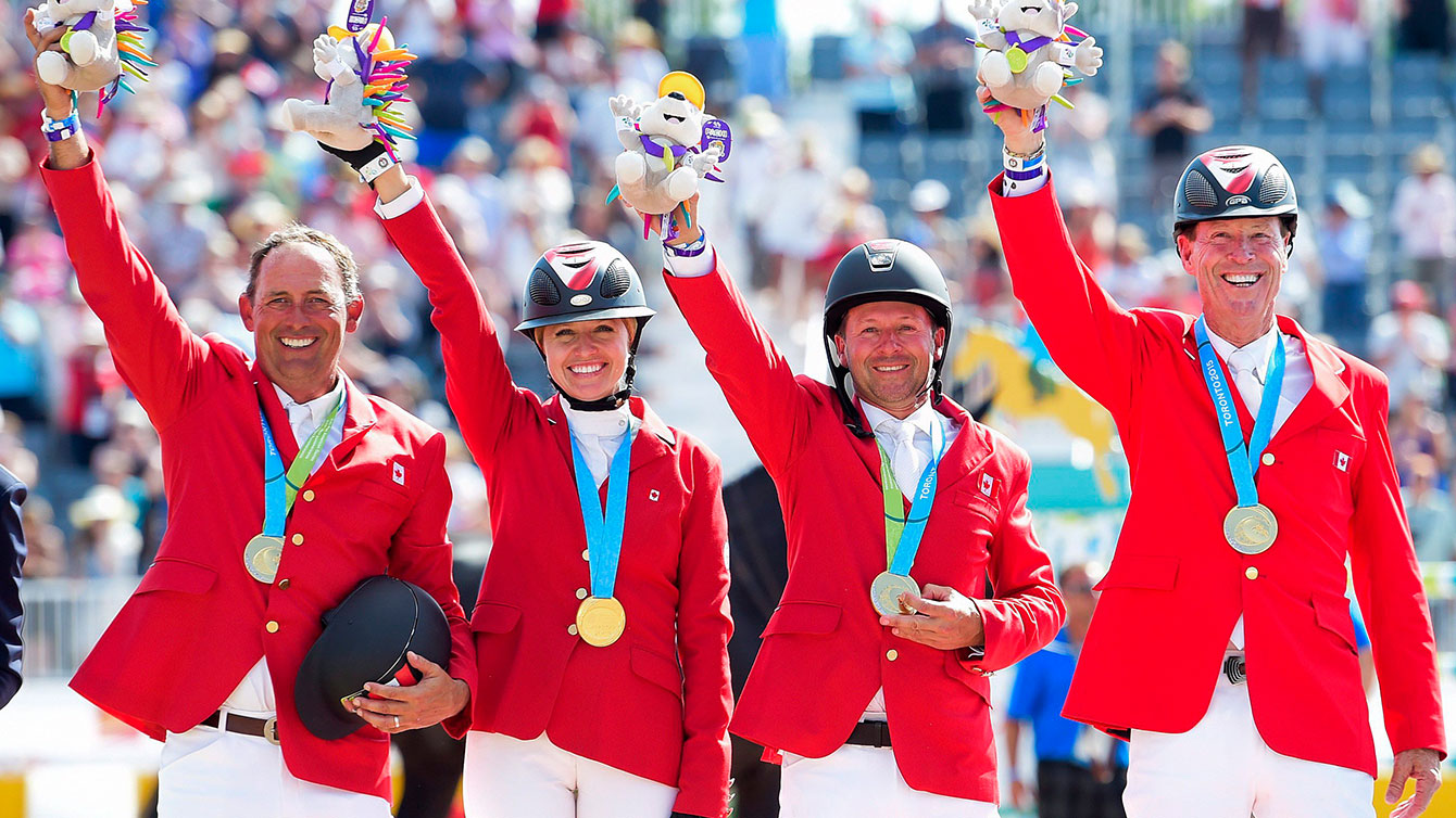 The show jumping team of (from left to right) Yann Candele, Tiffany Foster, Eric Lamaze and Ian Millar took TO2015 gold in the team jumping event on Day 13.