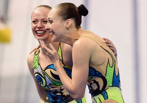 Jacqueline Simoneau (left) and Karine Thomas react after their free routine final at the Toronto 2015 Pan American Games, the pair won the gold medal and an Olympic spot. (Photo: CP)