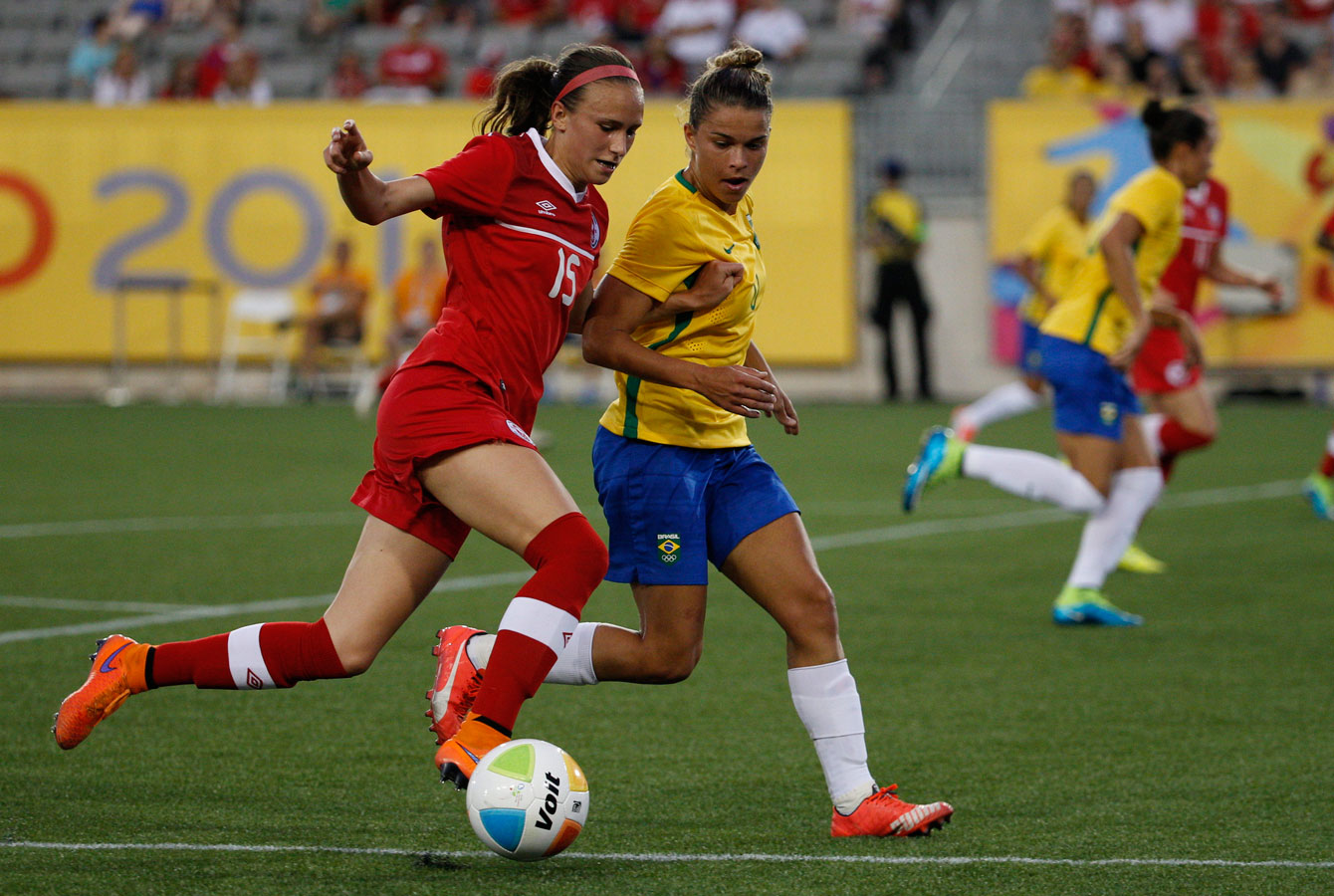 Team Canada's women's soccer team in action during a preliminary match against Brazil at TO2015