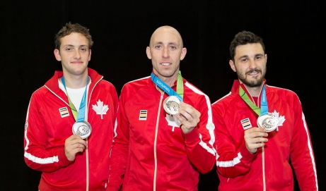 Shaul Gordon, Mark Peros and Joseph Polossifakis posing with their medals