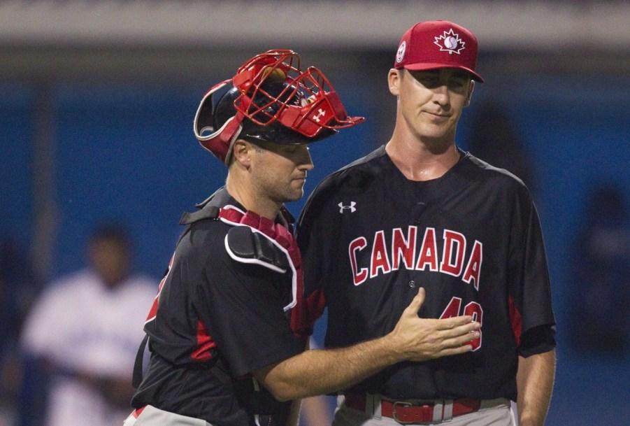 Scott Richmond being embraced by catcher