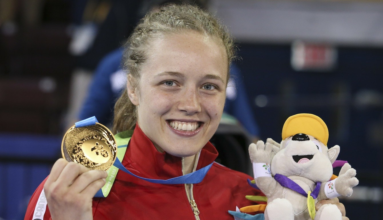 Dorothy Yeats (blue) of Montreal defeated Maria Acosta of Venezula for the gold medal in the freestyle wrestling finals at the PanAmerican Games in Mississauga, Ont.