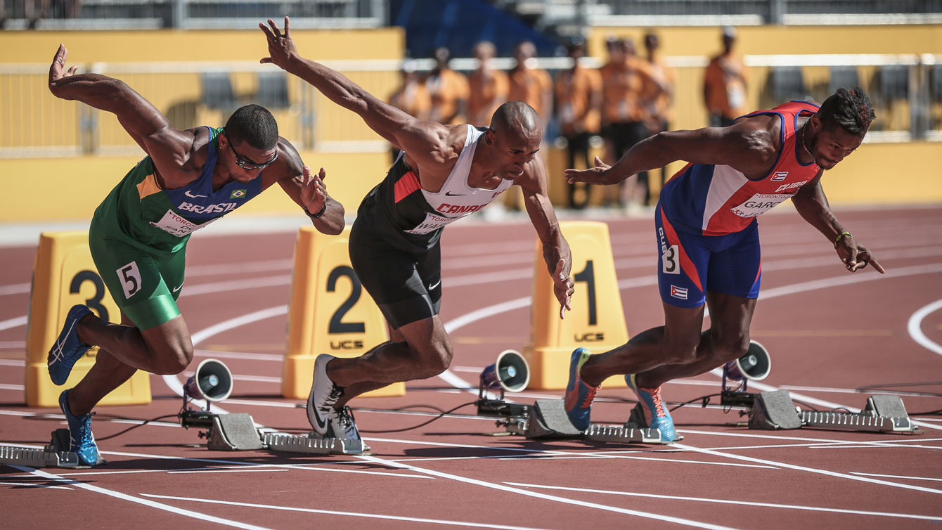 Damian Warner takes off in the 100m to start his events in the Pan Am Games decathlon on July 22, 2015 in Toronto.